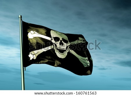 Pirate skull and crossbones flag waving in the evening - stock photo