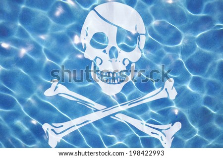 "Pirate themed ""watery grave"" concept  - stock photo"