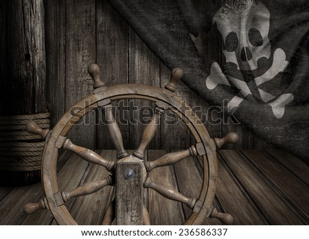 Pirates ship steering wheel with old jolly roger flag - stock photo