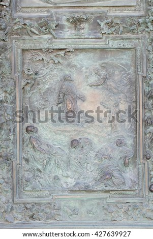PISA, ITALY - JUNE 06, 2015: Agony in the Garden, artwork from the school of Giambologna, panel from the bronze door of the Cathedral St. Mary of the Assumption in Pisa, Italy on June 06, 2015 - stock photo
