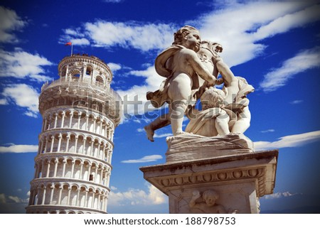 Pisa, Italy: leaning tower and Fontana dei putti - stock photo