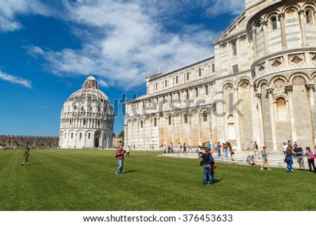 PISA , ITALY - SEPTEMBER 21, 2015 : Side view of historical old Pisa Cathedral in Cathedral Square in Pisa, Italy, on cloudy blue sky background. - stock photo