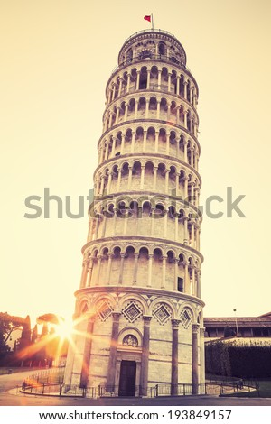 Pisa leaning tower at sunrise, Italy. Special photographic processing - stock photo