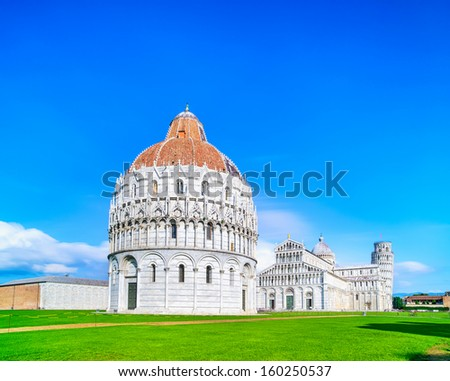 Pisa, Miracle Square view. Bapstistry, cathedral Duomo and Leaning Tower of Pisa. Unesco World Heritage site. Tuscany, Italy, Europe. - stock photo