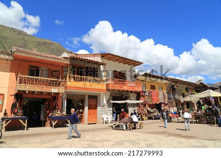Pisac, Peru - April, 20 2014 : The famous Sunday market in Pisac, Peru where tourist will find all kinds of handicrafts,antiques,Alpaca wool clothing and local food. - stock photo
