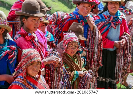 PISAC, PERU - MARCH 5, 2006: Unidentified people at Inca citadel in Sacred Valleyl near Pisac in Peru. Sacred Valley of the Incas in the Southern Sierra contains many famous and beautiful Inca ruins - stock photo