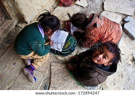 PISANG, NEPAL - NOVR 4: Unidentified Tibetan children in a local school on the famous Annapurna trail on November 4, 2008, in Pisang village Nepal. The majority of the local population are Tibetans. - stock photo