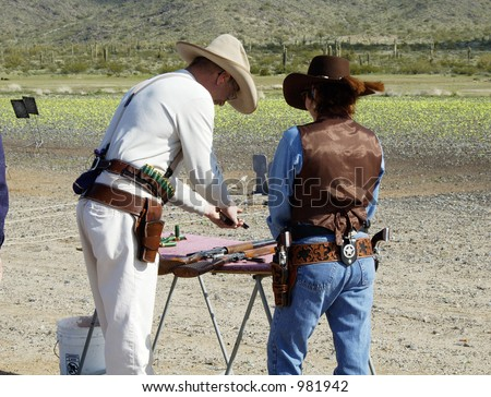 Pisotls, rifle and shotgun going throuth a safety check at a cowboy shooting competition. - stock photo