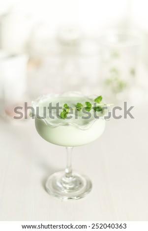 pistache avocado vanilla and a little white chocolate, natural ingredient milkshake  - stock photo