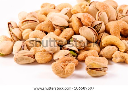 Pistachio and cashew nuts mixed - stock photo