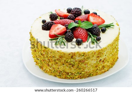 pistachio cake with berry compote and rosemary mousse on a white background. tinting. selective focus - stock photo