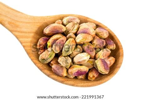 pistachio in scoop isolated on white - stock photo