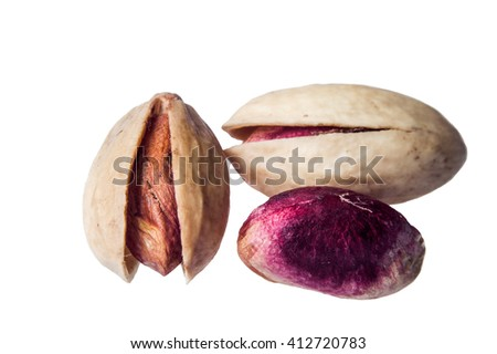 pistachio isolated on a white background. selective focus with shallow depth of field - stock photo