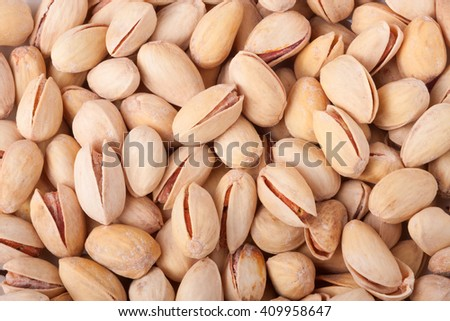 Pistachio nuts as a background close up macro - stock photo