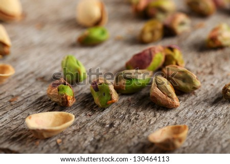 Pistachio nuts on the table - stock photo