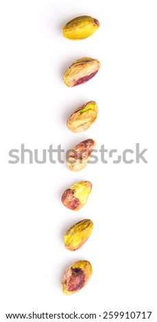 Pistachio nuts over white background - stock photo