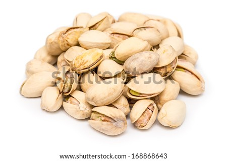 Pistachio Nuts Pile On White Background - stock photo