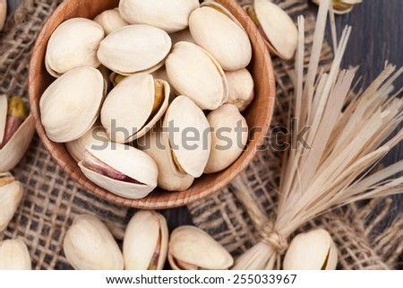 Pistachio super food mix in a wooden bowl - stock photo