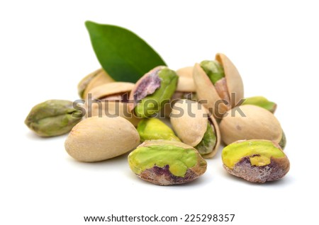 pistachios close up. Isolated on a white background.  - stock photo