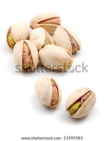 Pistachios over white - stock photo