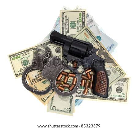 Pistol, ammunition, handcuffs, money, isolated on a white background - stock photo
