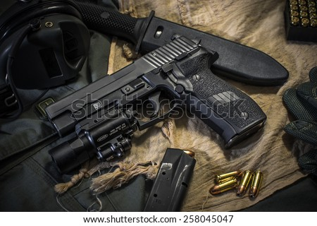 pistol and bullet background - stock photo