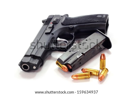 Pistol and  bullets  on white background - stock photo