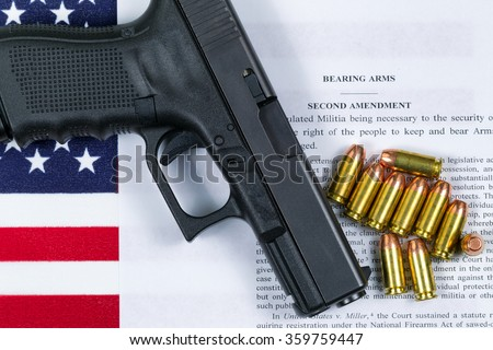 Pistol, bullets, USA flag and Text of second amendment for the right to bear arms.  - stock photo