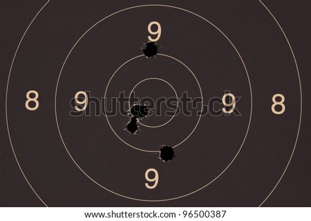 Pistol 25 meter target with 5 holes, 50 scored - stock photo