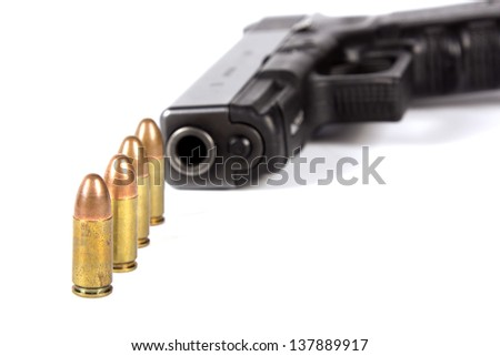Pistol 9mm and bullets isolated on white background - stock photo