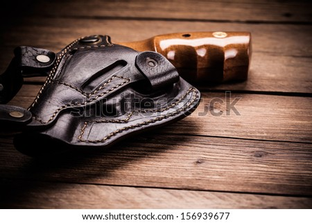 pistol on a wood background - stock photo