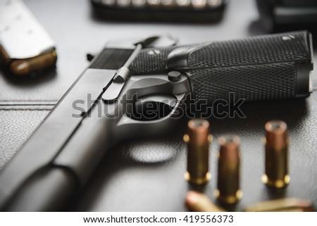 Pistol semi-automatic .45 caliber - stock photo