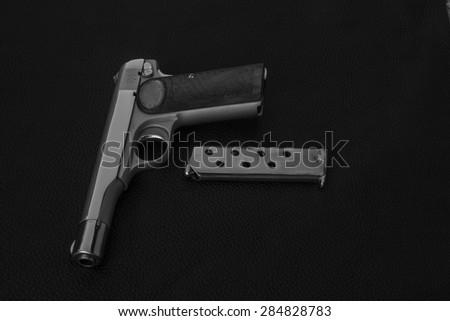 pistol with magazine and ammo - stock photo