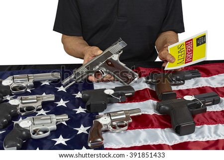 Pistols and revolver assorted firearms for sale on USA America flag at gun show - stock photo