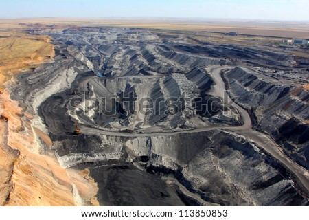 pit on coal mining by open way - stock photo