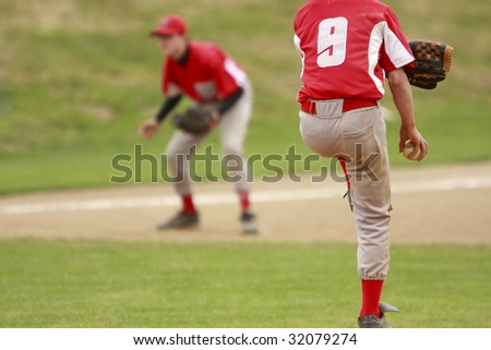 Pitcher and third baseman during a baseball game. - stock photo