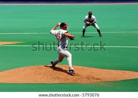 Pitcher, left-handed, Pitcher in full-wind-up - stock photo