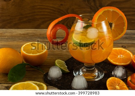 Pitcher of cool lemonade on wooden table. Summer drink.  Fruit cocktail. Fruit drink. Fruit lemonade. Citrus lemonade - stock photo