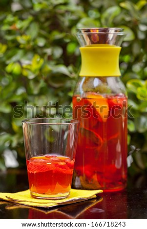 Pitcher of fruit drink on the table - stock photo