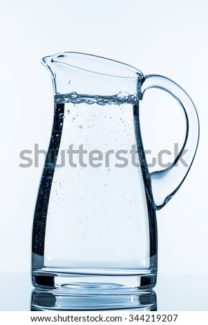 pitcher of water, symbol photo for drinking water, refreshments, supplies and consumables - stock photo