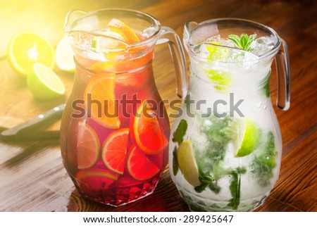 pitcher refreshing refreshing drink. a large portion of mojito and sangria. toned photo - stock photo