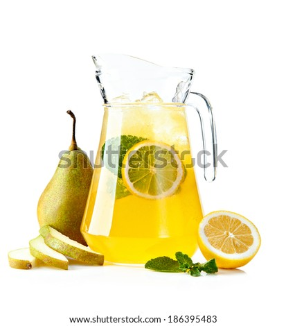 pitcher with a refreshing punch (duchess pear), with fruit on a white background - stock photo