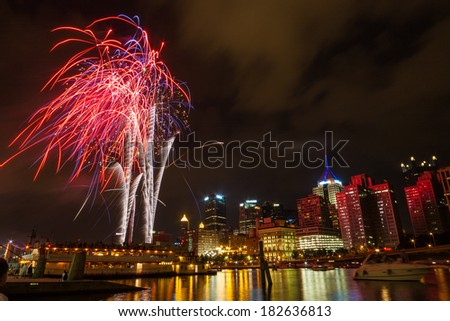 Pittsburgh downtown skyline by the river at night with colorful firework - stock photo