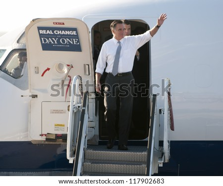 PITTSBURGH, PA - NOVEMBER 6:  Presidential candidate Mitt Romney emerges from his plane on election day during a brief stop in Pittsburgh, PA on November 6, 2012. - stock photo
