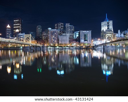 Pittsburgh Pennsylvania waterfront and bridges late at night. - stock photo