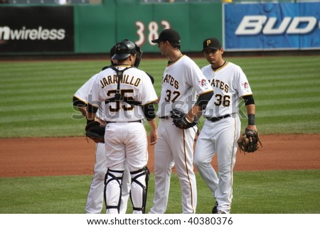 PITTSBURGH - SEPTEMBER 24 : Charlie Morton and his catcher Jason Jarmillo  of Pittsburgh Pirates have a conference on the mound against Cincinnati Reds on September 24, 2009 in Pittsburgh, PA. - stock photo