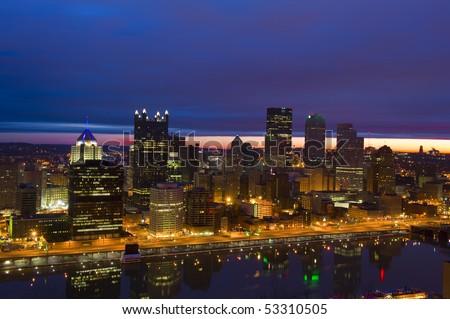 Pittsburgh skyline from Mount Washington at sunrise - stock photo