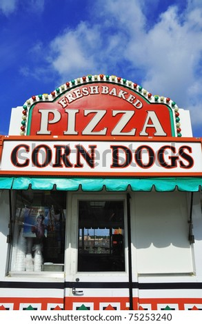 Pizza and Corn Dog sign at a fairgrounds - stock photo