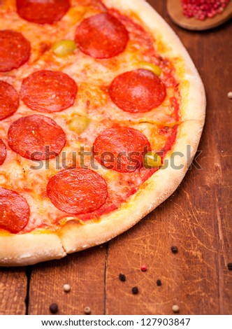 pizza and spices on wooden table - stock photo