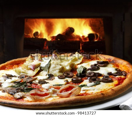 Pizza baked in wood oven - stock photo